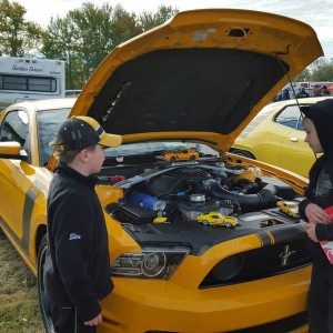 a couple of young lads, experiecing the magic of the car show.